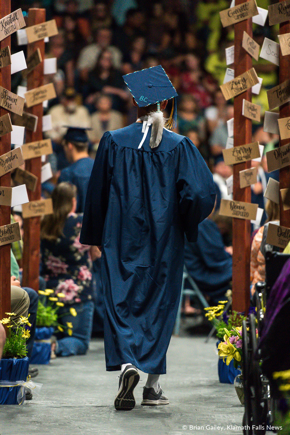 A graduate walks back to their seat after recieving a diploma at the Henley HS Graduation Ceremony. June 10, 2018 (Brian Gailey).