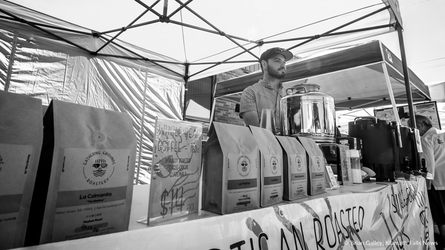 Jason Aarstad, Owner of Gathering Grounds Roastery offers locally roasted coffee at the Klamath Falls Farmers' Market.  Aarstad also has a cafe located just down the street from the market. June 30, 2018 (Brian Gailey)