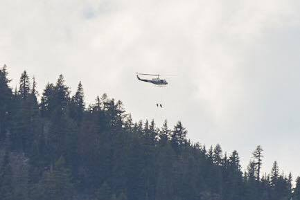 Smoke Jumpers rappel from a helicopter to gain access to the fire start on top of Brown Mountain in far western Klamath County. July 15, 2018 (Brian Gailey)