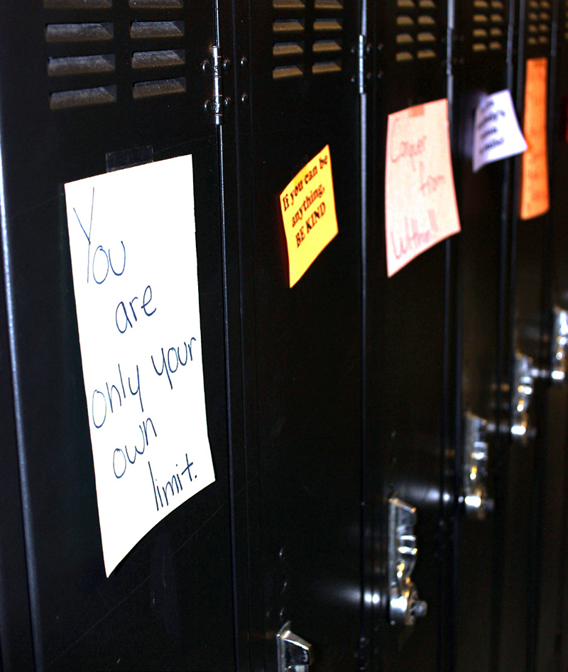 Notes on lockers in the school's hallways encourage students to think positively.