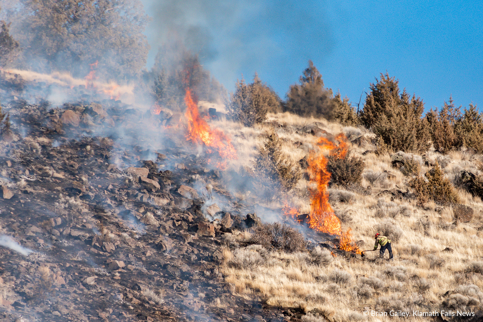 A firefighter battles flames on Stukel Mountain in Klamath Falls, Oregon. January 14, 2019 (Brian Gailey)