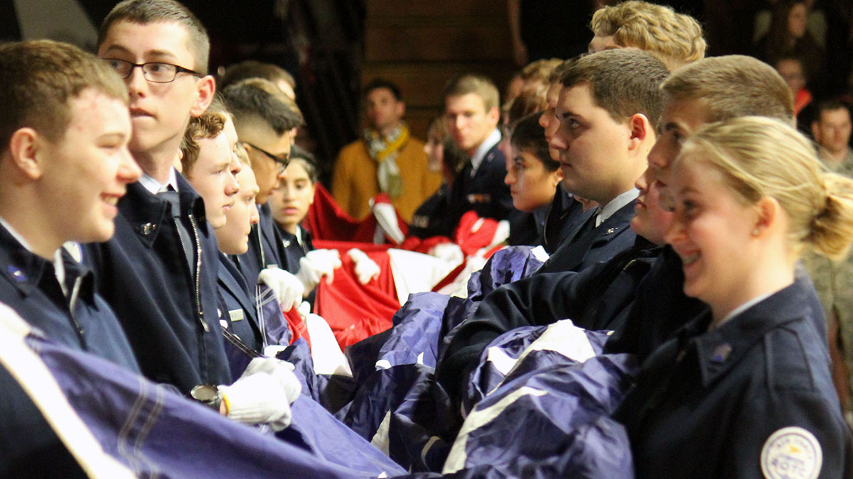 JrROTC Cadets prepare the flag for the National Anthem.