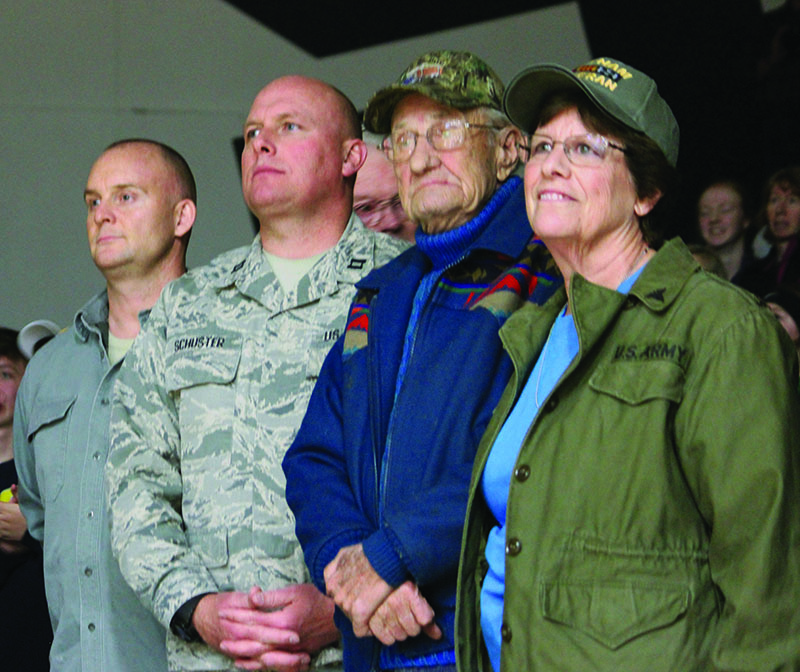 Tech Sgt. Michael McCormick and Capt. Rich Schuster, both of the 173rd Fighter Wing, stand with veterans Wayne Newbert and Sherry Harper during Military Appreciation Night at Henley High School.