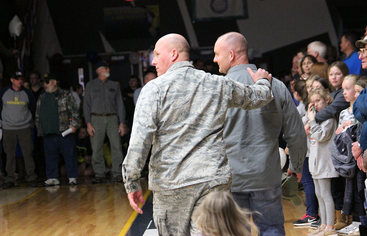 Captain Rich Schuster embraces Tech Sgt. Michael McCormick. Both of the 173rd Fighter Wing at Kingsley Field.