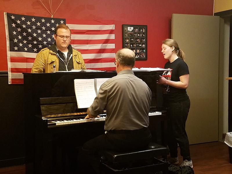 Left to right, Jeff Gardner as Freddy Benson, Dan Crenshaw, Musical Director, Sarah Smart as Christine Colgate. Image by, Chip Massie.