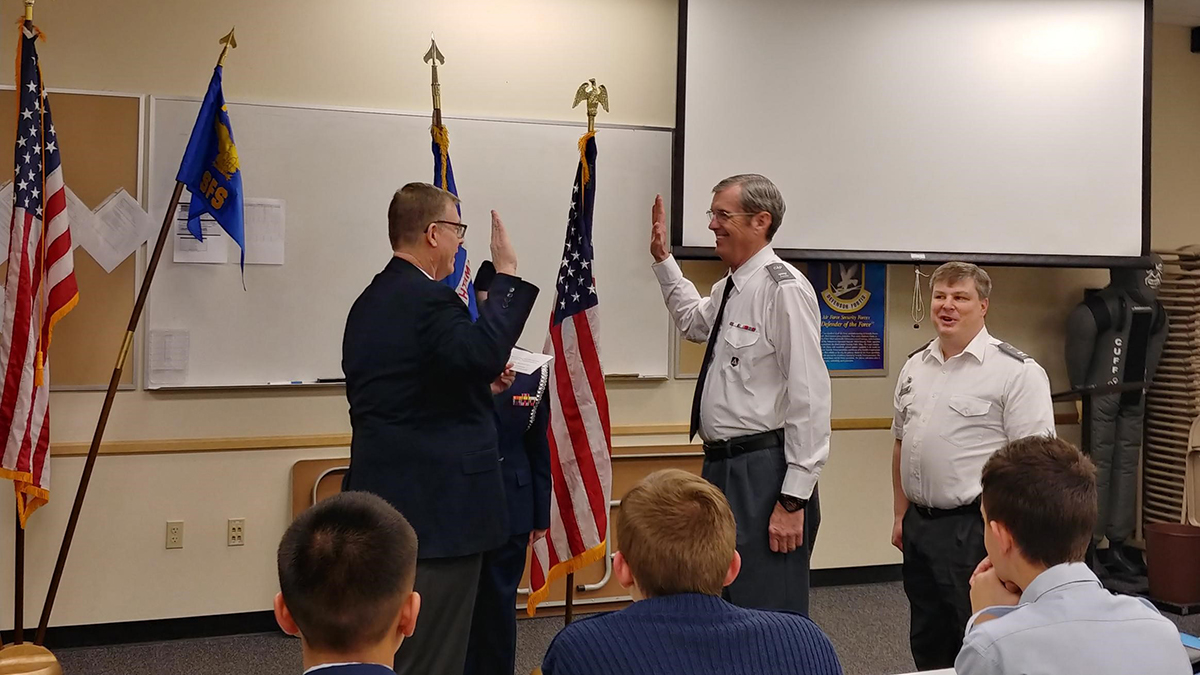 Colonel Ray administering oath of command to Captain Cliff Warrick during the Klamath Falls Civil Air Patrol change of command ceremony Thursday, Feb 7, 2019. Submitted Photo