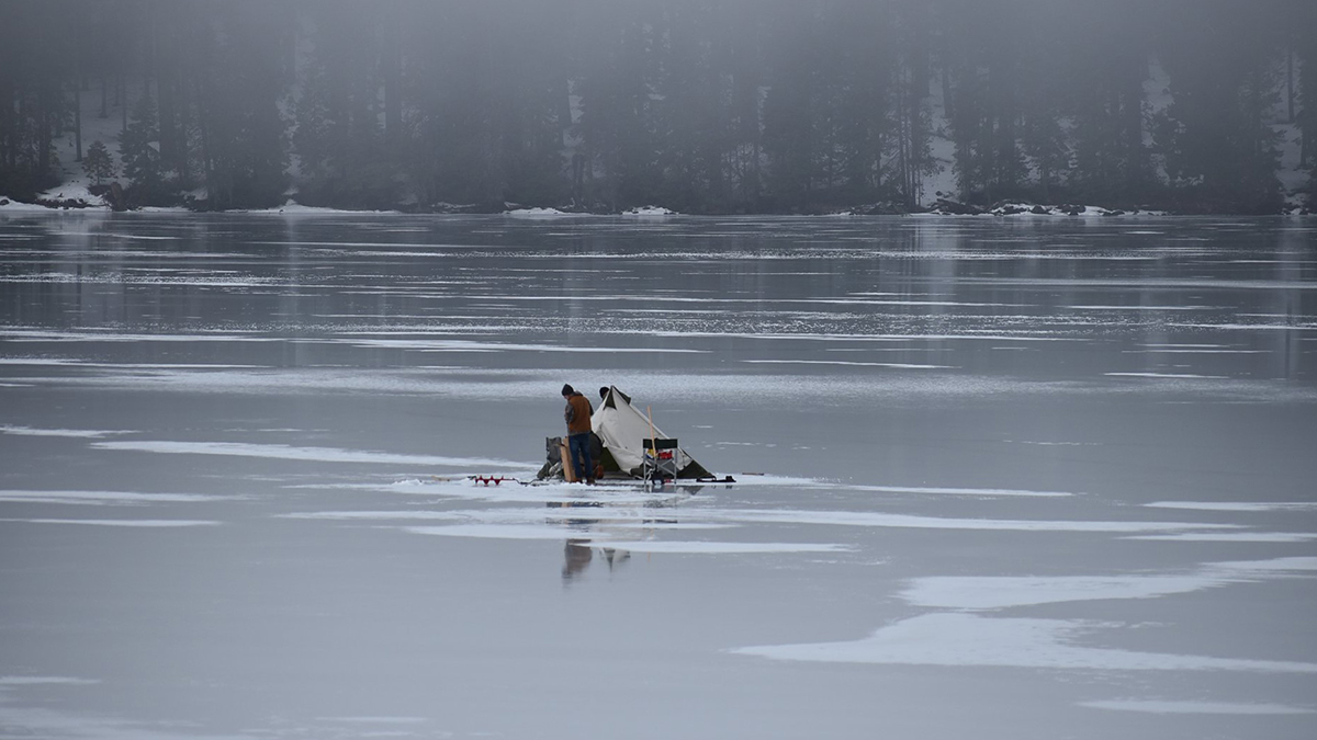 Fisherman with a tent on a frozen Lake of the Woods, Oregon. Reportedly trout and perch are being cought on worms in 12 to 30 feet of water. (Image,  Lake of the Woods Resort Facebook )