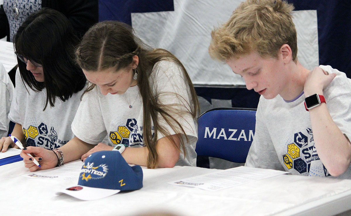 Mazama High School freshmen sign STEM&M contracts during an induction ceremony Wednesday.