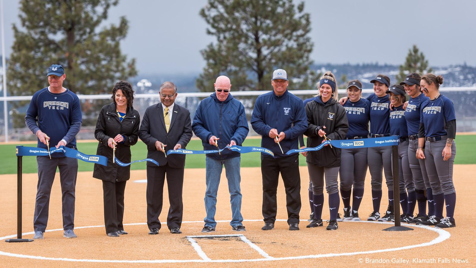 Ribbon cutting during the dedication of the John and Lois Stilwell softball stadium at Oregon Tech. March 23, 2019 (Image: Brandon Gailey / Klamath Falls News)