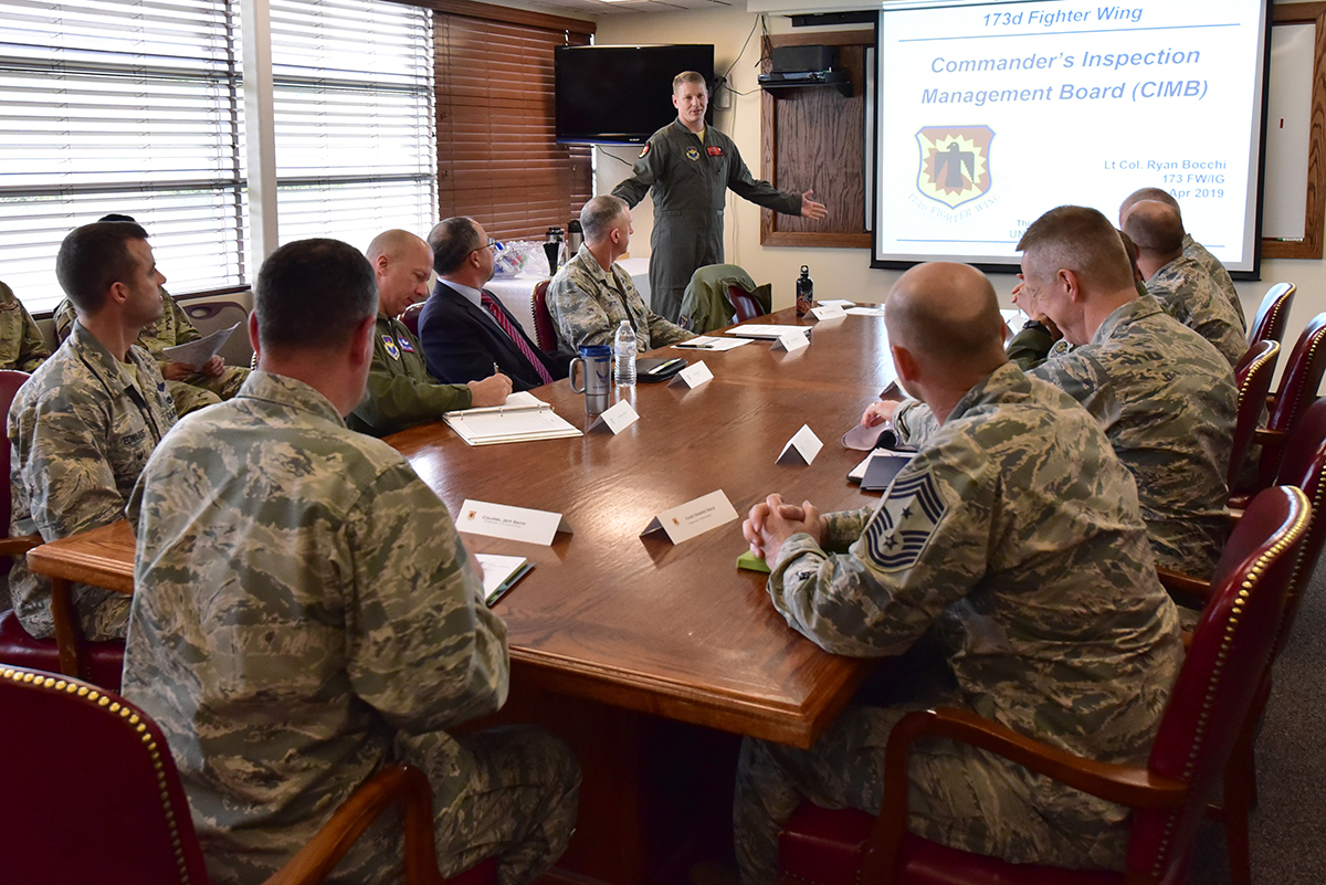 U.S. Air Force Lt. Col. Ryan Bocchi, 173rd Fighter Wing Inspector General, briefs wing leadership on the Commander's Inspection Management Board as members of the Air Force Inspection Agency observe during the 173rd FW Unit Effectiveness Inspection capstone event April 5, 2019 at Kingsley Field in Klamath Falls, Oregon. The capstone inspection is culmination of on ongoing virtual inspection on the effectiveness of the unit through four major graded areas—managing resources, leading people, improving the unit, and executing the mission. (U.S. Air National Guard photo by Senior Master Sgt. Jennifer Shirar)