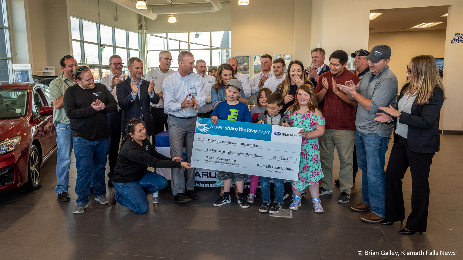Friends of the Children, Klamath Basin receives a check for $6847 from Klamath Falls Subaru as part of the Subaru Share the Love Event.