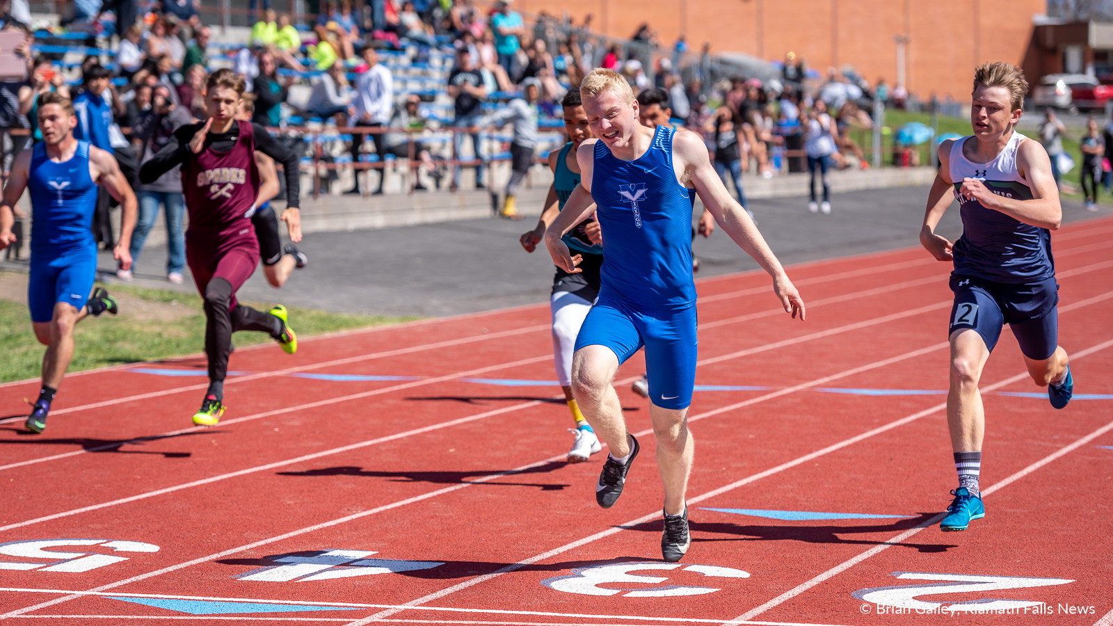 Mazama's Ben Carringer steps across the finish line at 23.49 and into first place in the boys 200 meters during the 27th Annual Lithia Track and Field Invitational. April 27, 2019 (Image, Brian Gailey / Klamath Falls News)