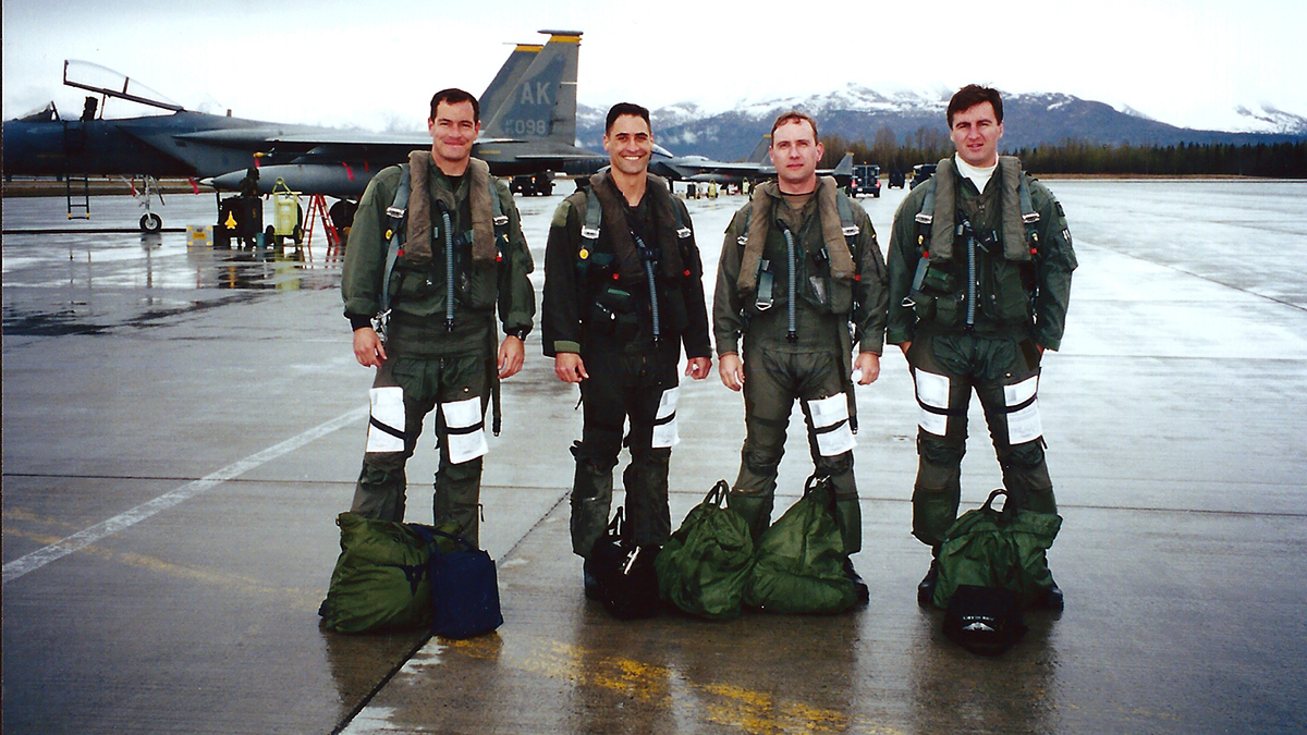 U.S. Air Force Captain Jeff Smith (left), the current 173rd Fighter Wing commander, smiles with a group of F-15 pilots prior to a mission at Elmendorf Air Force Base, Alaska in early 2000s. Smith was stationed at Elmendorf at the same time as the 173rd FW Vice Commander, Col. Jeff Edwards, and their careers have overlapped from the beginning as they arrived at the Air Force Academy on the same day. (Courtesy photo from Col. Jeff Smith)