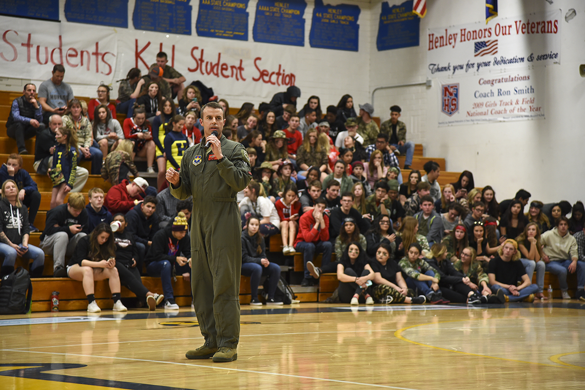 U.S. Air Force Col. Jeff Edwards, the 173rd Fighter Wing vice commander, speaks to the audience during a Henley High School military appreciation night basketball game Feb. 6, 2018, in Klamath Falls, Ore. During half-time, Edwards spoke to the audience thanking them for their strong support of the base. (U.S. Air National Guard photo by Tech. Sgt. Jason van Mourik)
