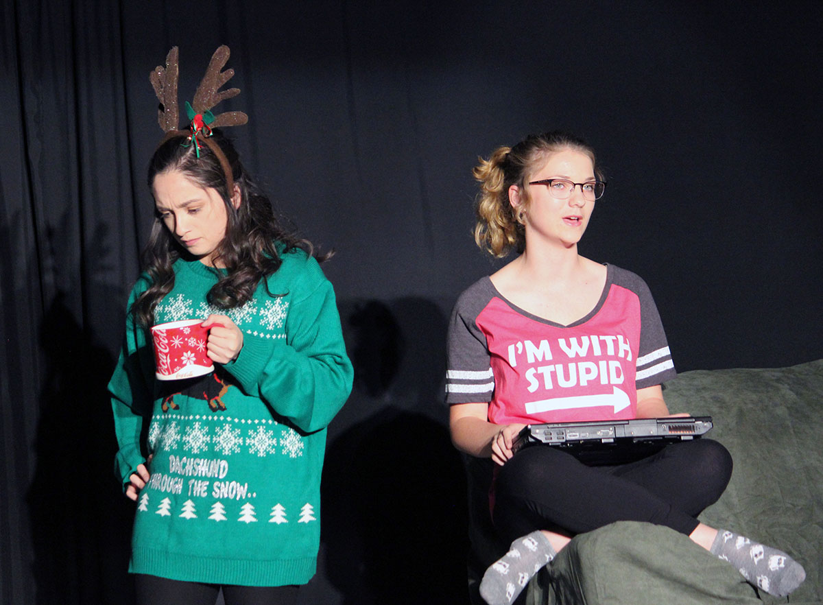 Mother (Avelina Alfaro) dictates a family Christmas letter while her daughter (Kira Driscoll) listens (and provides commentary).
