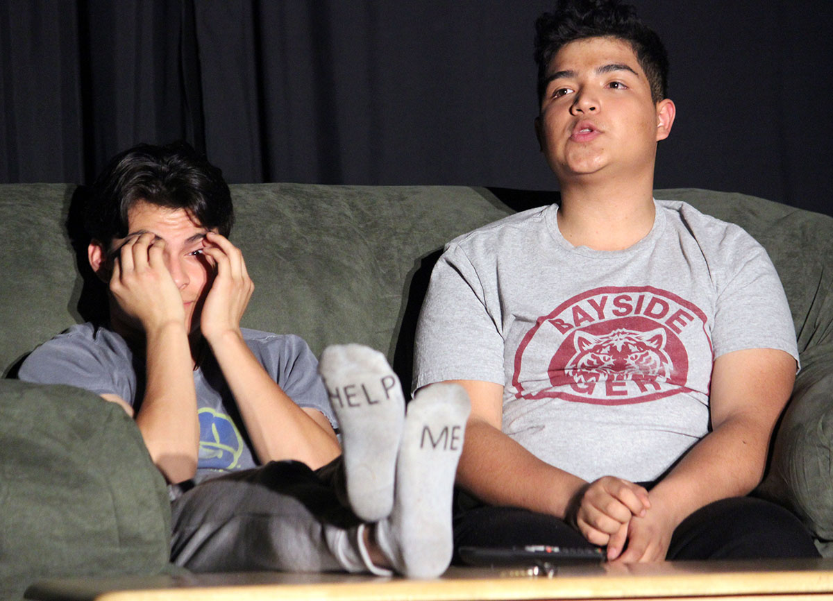 """Father, played by Victor Manzo, initiates """"the talk"""" with his son, played by Rigo Cruz, during scene 6 of the comedy """"Parents Just Don't Understand."""""""