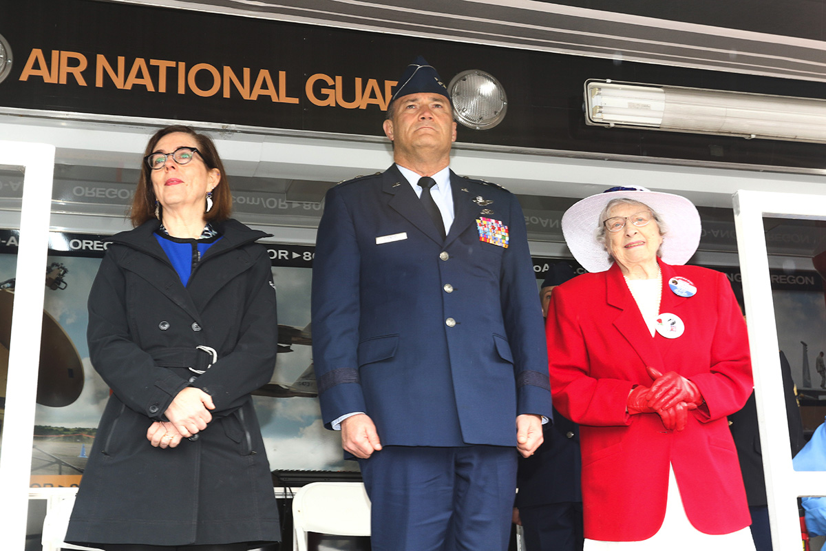 "Oregon Governor Kate Brown (left) along with Maj. Gen. Mike Stencel, Adjutant General, Oregon (center) and official honoree Joy Beebe, a WWII war bride, (right) stand for a howitzer salute by the ""Governor's Own"" Bravo Battery, 2-218th Field Artillery Battalion during the Armed Forces Day ceremony at the Oregon State Capital, Salem, Oregon, May 14, 2019. (Oregon National Guard photo by Maj. Wayne Clyne)"