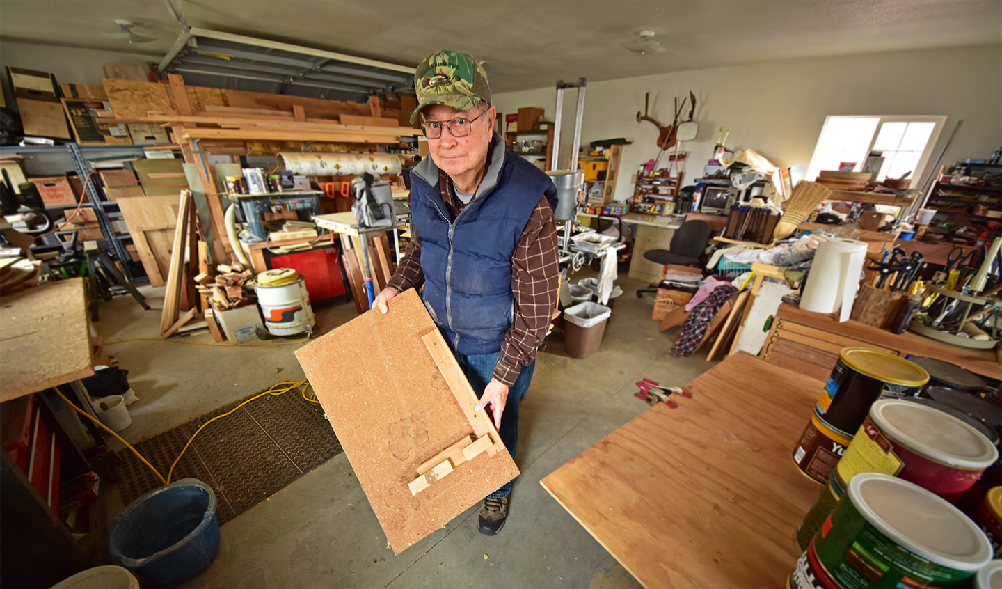 """In his shop in Malin, Oregon, Cy Phillips displays a kestrel nest box """"jig"""" he made to speed up production of the 80 boxes he and associates produced at the beginning of the project. Credit: Jon Myatt/USFWS"""