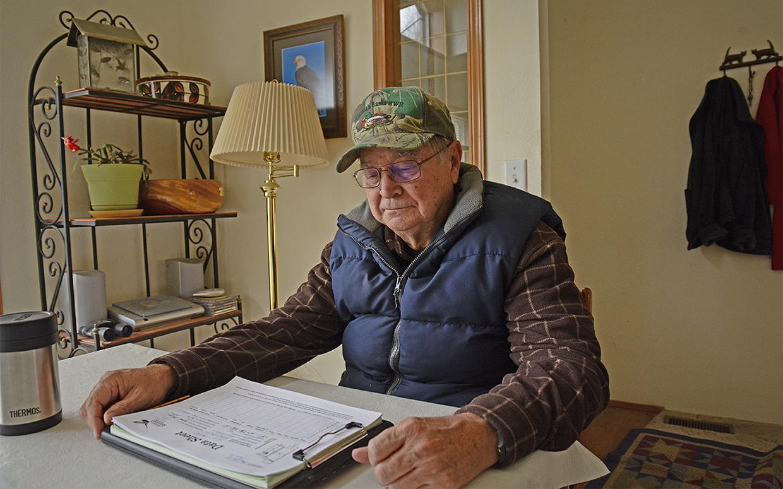 Preparing kestrel documentation forms at his dining room table at his home in Malin, Oregon, Cy Phillips readies for the 2019 kestrel nesting season. Credit: Jon Myatt/USFWS