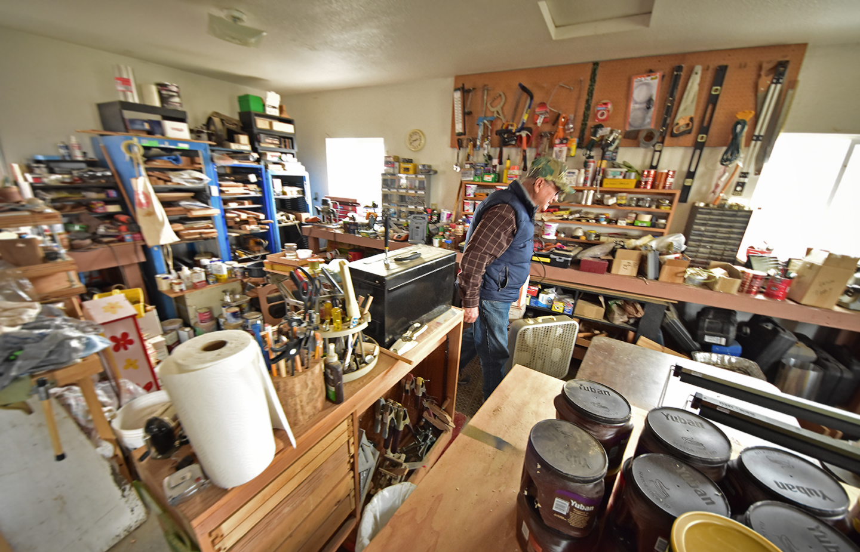 Cy Phillips working in his shop at his home in Malin, Oregon. Credit: Jon Myatt/USFWS