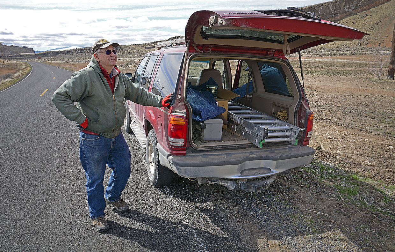 At the end of a loop, Cy looks up at his kestrel box mounted on a pole along Road 120 near Newell, California. Credit: Jon Myatt/USFWS