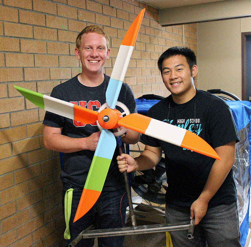 Thys DeHoop and Dylan Huynh pose with their wind turbine. The blades, hub and gears were created in a CAD program and 3D printed. They will compete next week at the National KidWind Challenge in Houston. (Not pictured: Team members Jeffrey Hudson and Andrew Wilcher)