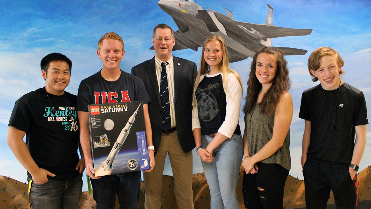 Henley High School engineering students Dylan Huhyn, Thys deHoop, JPLMuseum director James Loftus, Grace Parker, Alyssa Michaelis and MIchael Malineaux pose with a Lego model of the Saturn V rocket donated by Loftus of JPLMuseum.