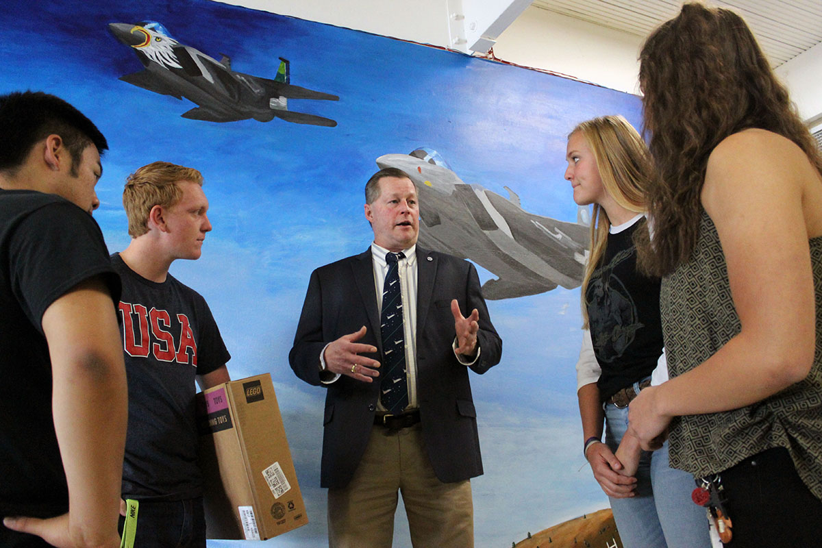 Henley High School engineering students Dylan Huhyn, Thys deHoop, Grace Parker and Alyssa Michaelis talk to James Loftus, director of JPLMuseum.