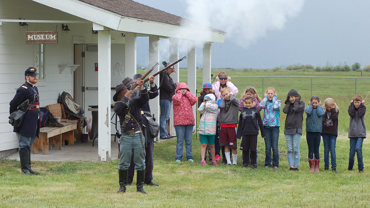 Living history re-enactors fire a rifle volley during last year's Heritage Days event at the Fort Klamath Museum.