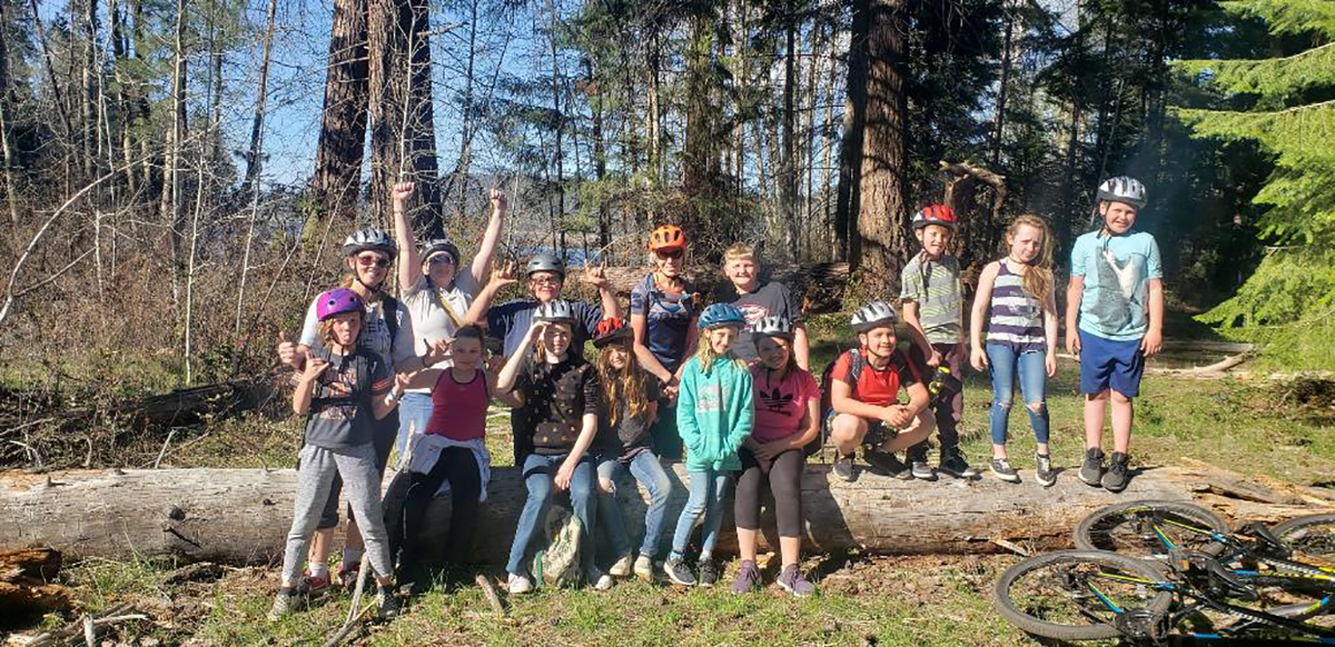 Members of Shasta Elementary School's mountain bike club pose for a team picture at the end of the Shoalwater Bay trail ride.
