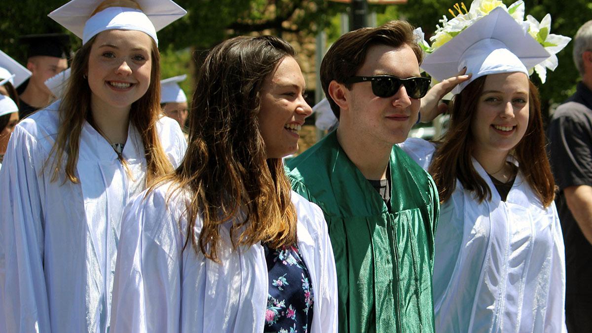 Gilchrist Junior-Senior High School seniors walk together down Main Street May 30 during the Graduation Sensation celebration. Seventeen Gilchrist seniors will celebrate their graduation Saturday.