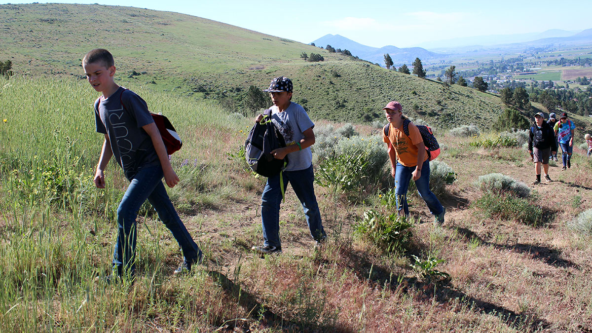 Bonanza sixth-graders on the trail to the summit of Hogback Mountain.