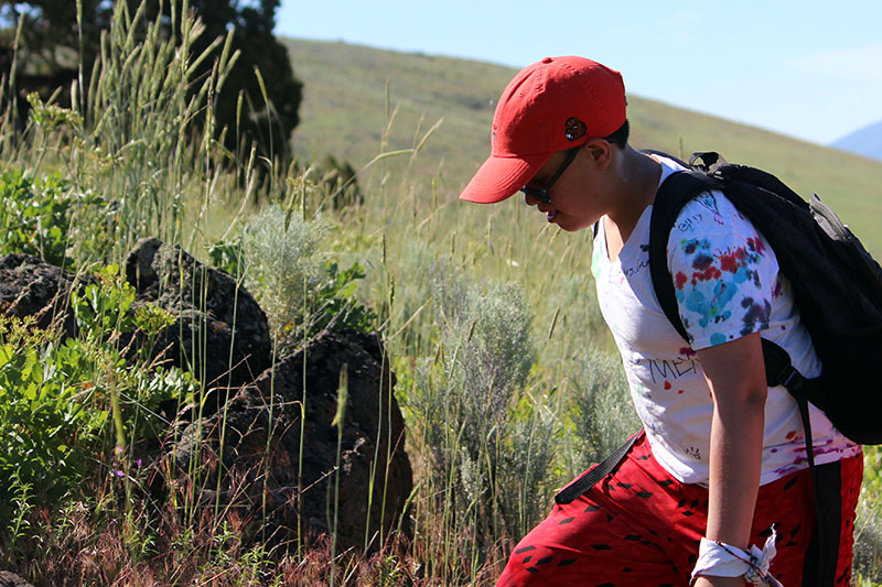 Bonanza sixth-grader Jorge Aguirre on the trail to the summit of Hogback Mountain.