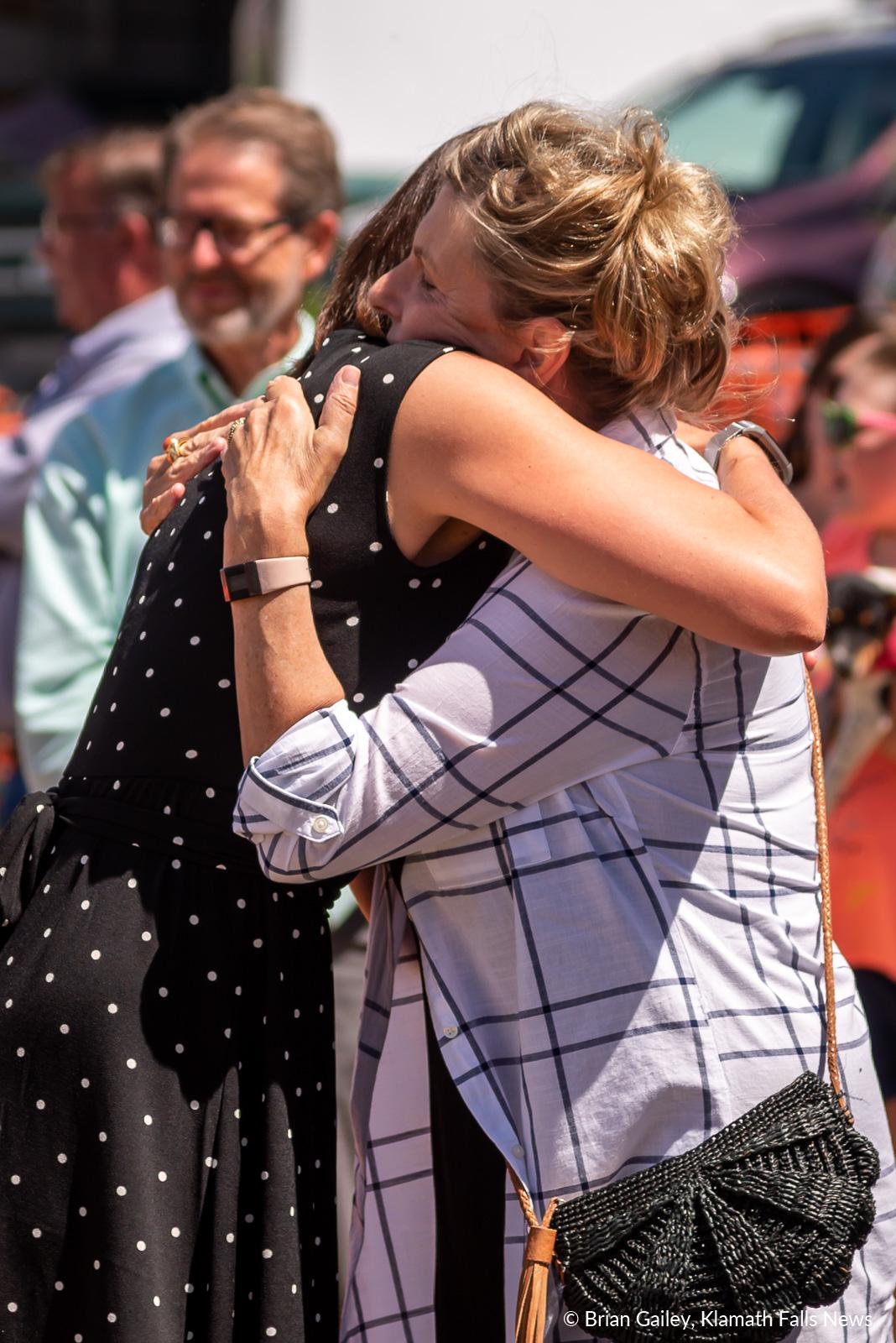 Katherine Pope and Heidi VanDyke embrace in a hug following the ribbon cutting of the Klamath Commons Park. July 1, 2019 (Image, Brian Gailey / Klamath Falls News)