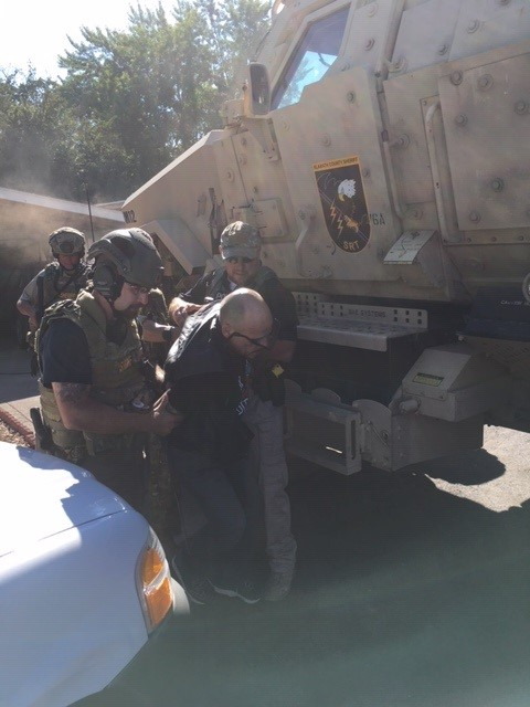 Anderson being taken into custody by the Klamath County Sherrif's Office Special Response Team (KCSO)