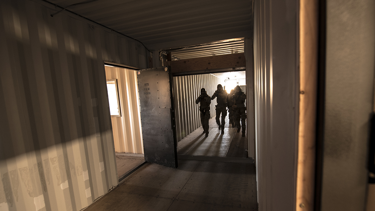 "A tactical team hones their skills in entering a hostile building at the newly constructed ""shoot house"" at Kingsley Field in Klamath Falls, Oregon, during a competition organized for its grand opening, July 24, 2019. The facility is the only one of its kind within a four hour driving radius and represents valuable training for both Airmen and community law enforcement partners. (U.S. Air National Guard photo by Master Sgt. Jefferson Thompson)"