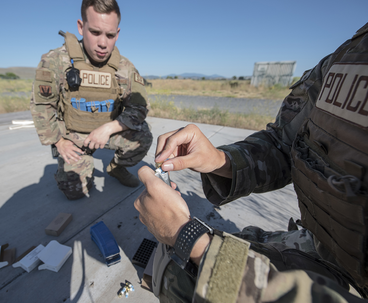 "A Security Forces Airmen from Beale Air Force Base, California loads Simunitions rounds into a magazine during a tactical team competition at Kingsley Field in Klamath Falls, Oregon as part of a grand opening for the newly constructed ""shoot house"", July 24, 2019. The facility is the only one of its kind within a four hour driving radius, prompting the active-duty unit to bring two teams in order to gain valuable training otherwise unavailable to them. (U.S. Air National Guard photo by Master Sgt. Jefferson Thompson)"