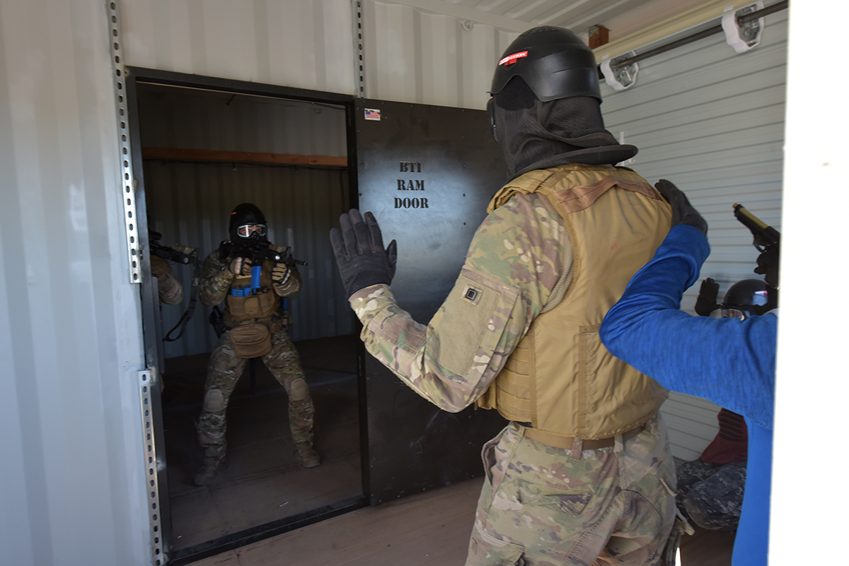 "Simuntion rounds fly as 9th Security Forces Squadron Airmen from Beale AFB, California slam open a breach/pry door and engage a hostile situation involving a hostage at the newly constructed ""shoot house"" on Kingsley Field in Klamath Falls, Oregon, July 24, 2019. The facility is the only one of its kind within a four hour driving radius; the 173rd Security Forces Squadron hosted a tactical team competition for the grand opening—prompting the active-duty unit to bring two teams in order to gain valuable training. (U.S. Air National Guard photo by Master Sgt. Jefferson Thompson)"