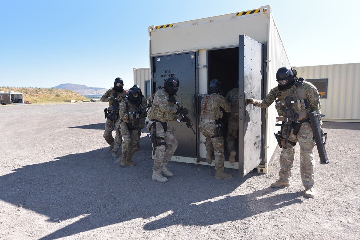 "Members of the 173rd Security Forces Squadron tactical team storm a new ""shoot house"" during competition organized for the grand opening of the training facility on Kingsley Field, in Klamath Falls, Oregon, July 24, 2019. The facility is the only one of its kind within a four hour driving radius, and represents valuable training for both Airmen and community law enforcement partners. (U.S. Air National Guard photo by Master Sgt. Jefferson Thompson)"