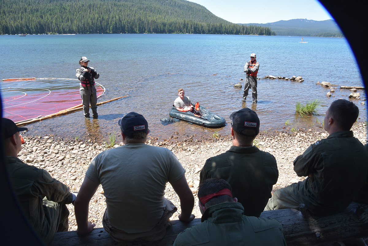 173rd Fighter Wing Aircrew Flight Equipment Airmen administer water survival training with the help of Survival, Evasion, Resistance and Escape instructor Staff Sgt. Joe Halloran for wing F-15C Instructor pilots at Cultus Lake, Oregon, July 25, 2019. The training occurs every three years, and is necessary for flying the F-15C over water, something these pilots do when using the ranges over the Oregon and California Coast. (U.S. Air National Guard photo by Master Sgt. Jefferson Thompson)