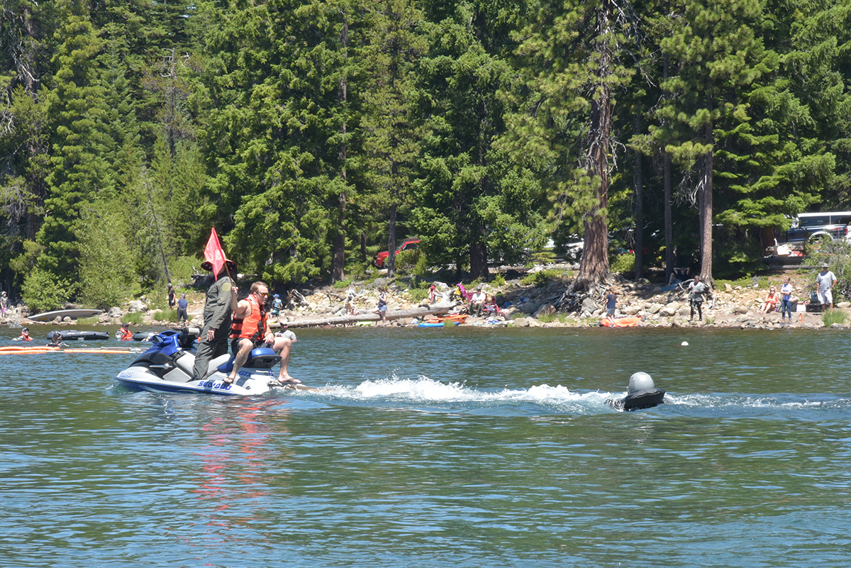 U.S. Air Force F-15C pilots from the 173rd Fighter Wing train on a simulated parachute drag, releasing their harness while being dragged behind a personal watercraft at Cultus Lake, Oregon, July 25, 2019. The training occurs every three years and is necessary for flying and training the F-15C over water, something these pilots do when using the ranges over the Oregon and California Coast. (U.S. Air National Guard photo by Master Sgt. Jefferson Thompson)