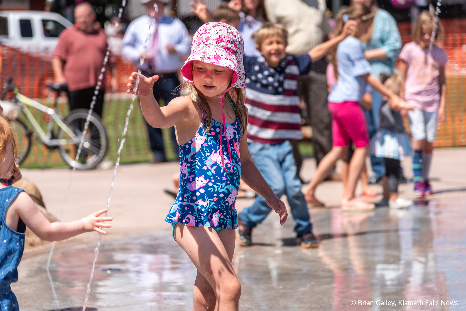 A child plays in the Klamath Commons Splash Pad on opening Day, July 1, 2019 (Image, by Brian Gailey / Klamath Falls News)