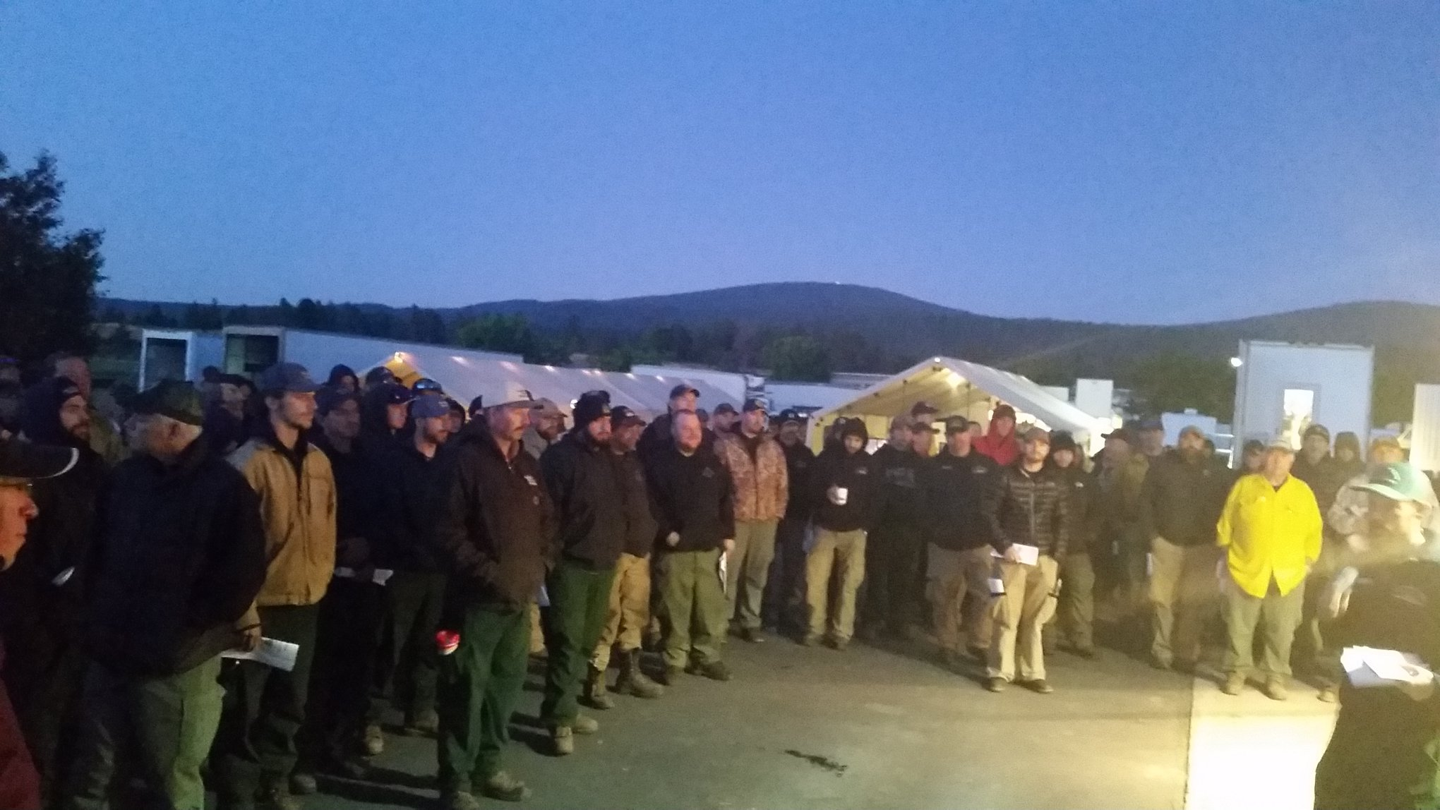Firefighters gather for the morning briefing. (Ward Fire Facebook)