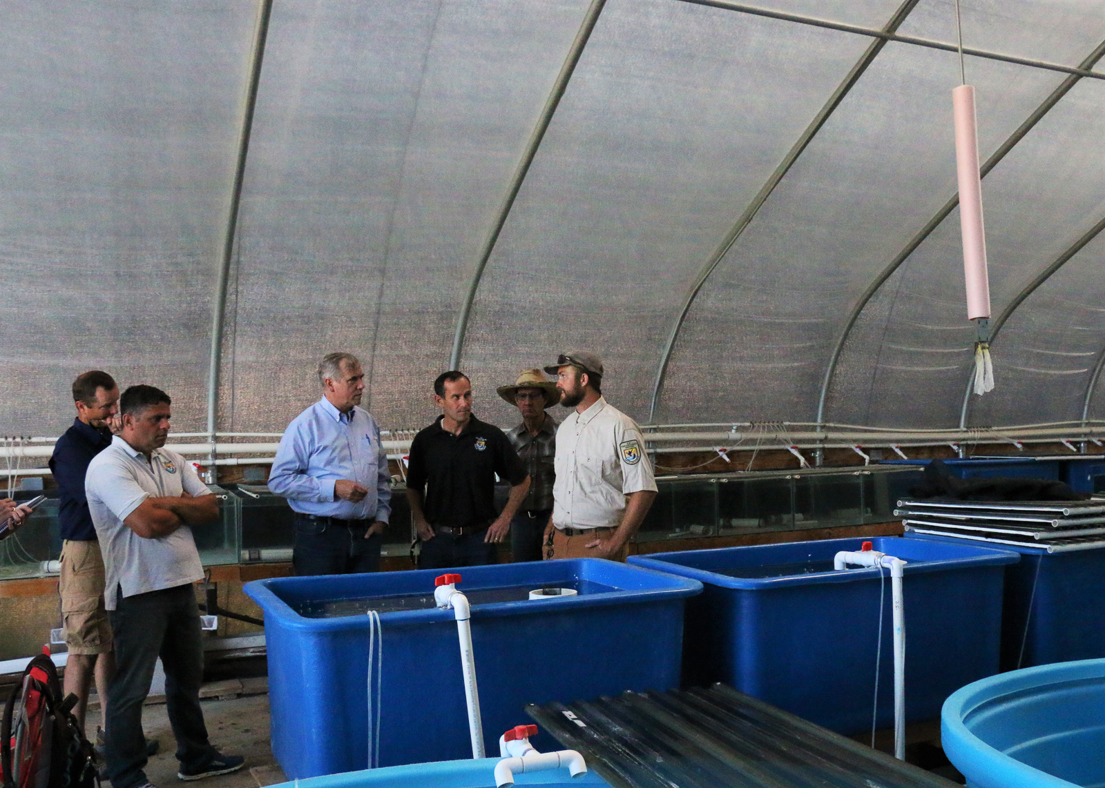 Merkley tours the Lost River and Shortnose Suckerfish rearing facility at Gone Fishing. August 12, 2019 (Image: Sara Hottman)