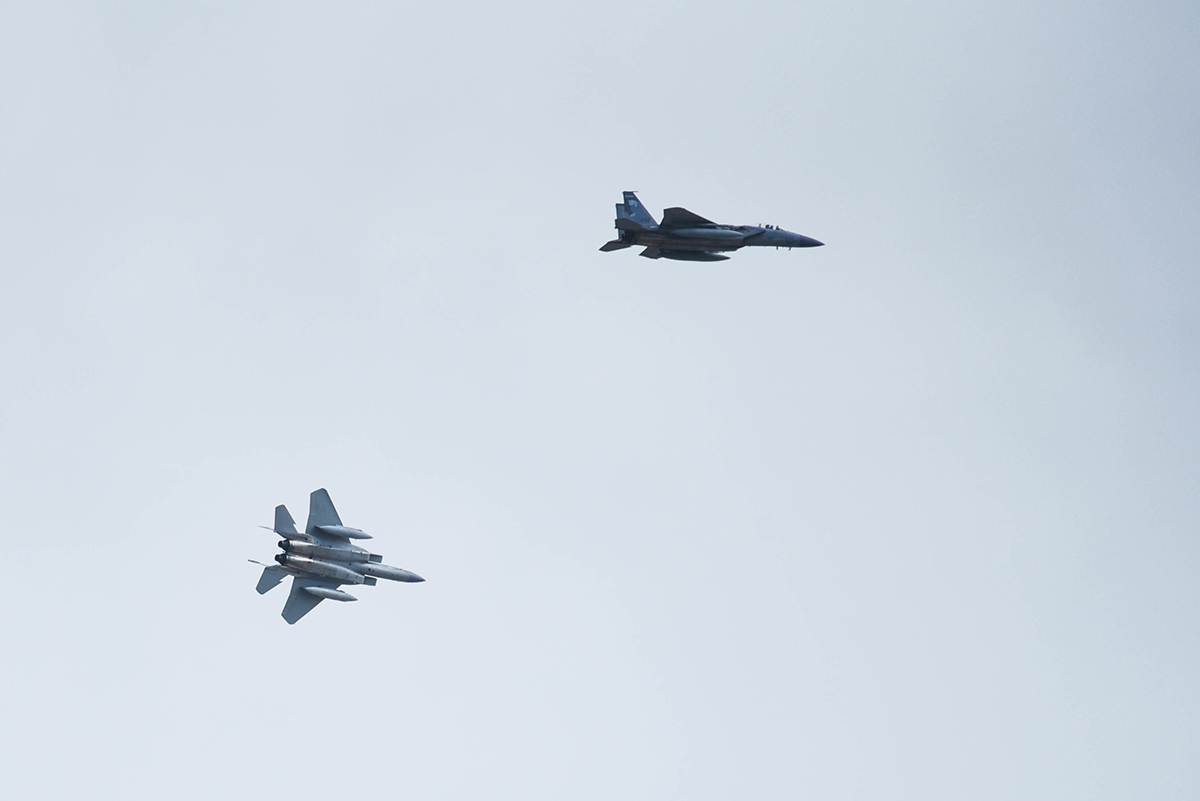 Two United States Air Force F-15 Eagles from the 173rd Fighter Wing out of Kingsley Field in Klamath Falls, Oregon, maneuver over Joint Base Pearl Harbor-Hickam, August 21, 2019. Aircraft from around the world took part in Joint Exercise Sentry Aloha, a three week coalition exercise at Joint Base Pearl Harbor-Hickam in Honolulu, Hawaii. (U.S. Air National Guard Photo by Airman First Class Adam Smith)