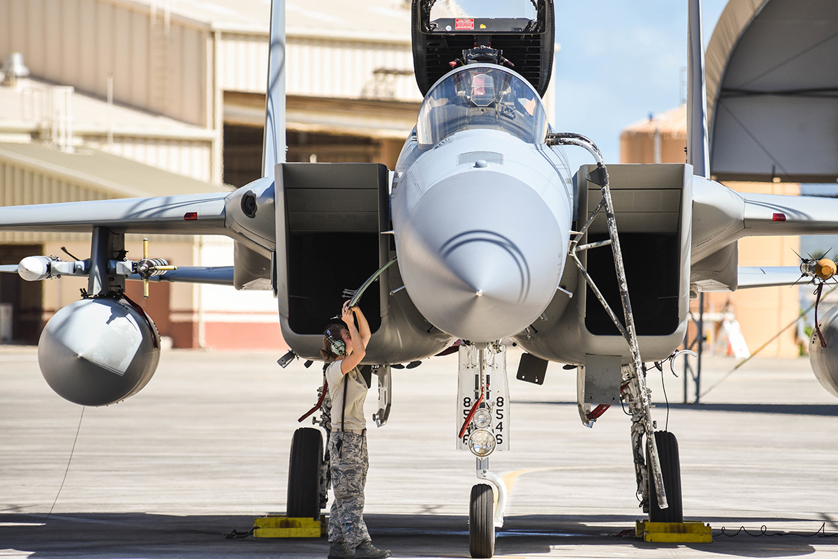 U.S. Air Force Senior Airman Tiffani Patrick, 173rd Fighter Wing avionics technician, examines an F-15 Eagle from Kingsley Field in Klamath Falls, Oregon, during the Sentry Aloha exercise at Joint Base Pearl Harbor-Hickam, August 21, 2019. Aircraft from around the world took partin Joint Exercise Sentry Aloha, a three week coalition exercise at Joint Base Pearl Harbor-Hickam in Honolulu, Hawaii. (U.S. Air National Guard Photo by Airman First Class Adam Smith)
