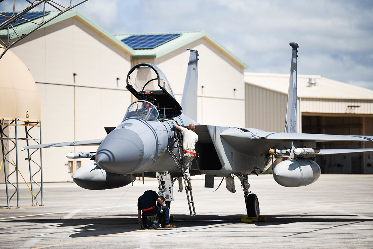 Airmen from the 173rd Fighter Wing examine an F-15 Eagle from Kingsley Field in Klamath Falls, Oregon, during the Sentry Aloha exercise at Joint Base Pearl Harbor-Hickam, August 23, 2019. Aircraft from around the world took part in Joint Exercise Sentry Aloha, a three week coalition exercise at Joint Base Pearl Harbor-Hickam in Honolulu, Hawaii. (U.S. Air National Guard Photo by Airman First Class Adam Smith)