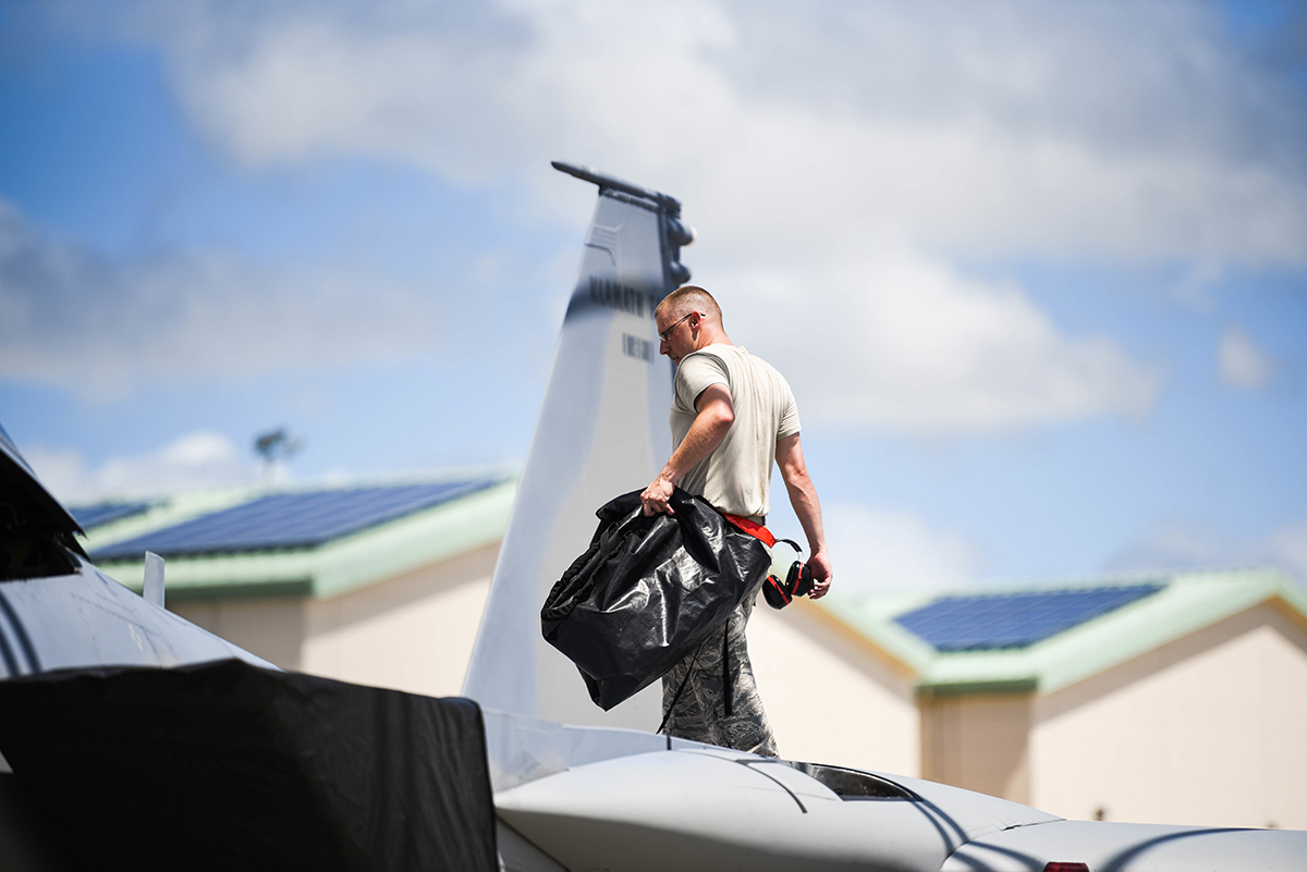 U.S. Air Force Staff Sergeant Michael Fleener, 173rd Fighter Wing Engine Technician, handles intake covers for an F-15 Eagle from Kingsley Field in Klamath Falls, Oregon, during the Sentry Aloha exercise at Joint Base Pearl Harbor-Hickam, August 23, 2019. Aircraft from around the world took part in Joint Exercise Sentry Aloha, a three week coalition exercise at Joint Base Pearl Harbor-Hickam in Honolulu, Hawaii. (U.S. Air National Guard Photo by Airman First Class Adam Smith)