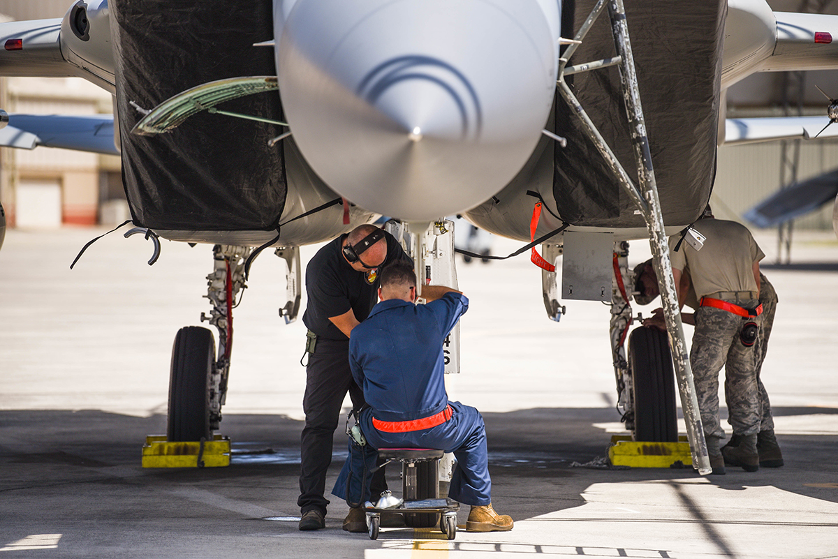 Airmen from the 173rd Fighter Wing work on an F-15 Eagle from Kingsley Field in Klamath Falls, Oregon, during the Sentry Aloha exercise at Joint Base Pearl Harbor-Hickam, August 23, 2019. Aircraft from around the world took part in Joint Exercise Sentry Aloha, a three week coalition exercise at Joint Base Pearl Harbor-Hickam in Honolulu, Hawaii. (U.S. Air National Guard Photo by Airman First Class Adam Smith)