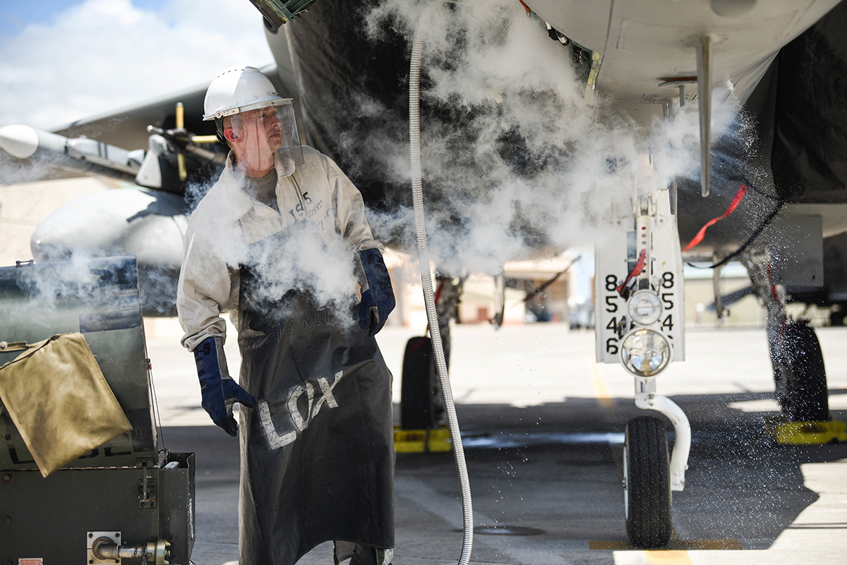 U.S. Air Force Senior Airman Kyel Beasley, 173rd Fighter Wing Crew Chief, loads liquid oxygen into an F-15 Eagle from Kingsley Field in Klamath Falls, Oregon, during the Sentry Aloha exercise at Joint Base Pearl Harbor-Hickam, August 23, 2019. Aircraft from around the world took part in Joint Exercise Sentry Aloha, a three week coalition exercise at Joint Base Pearl Harbor-Hickam in Honolulu, Hawaii. (U.S. Air National Guard Photo by Airman First Class Adam Smith)